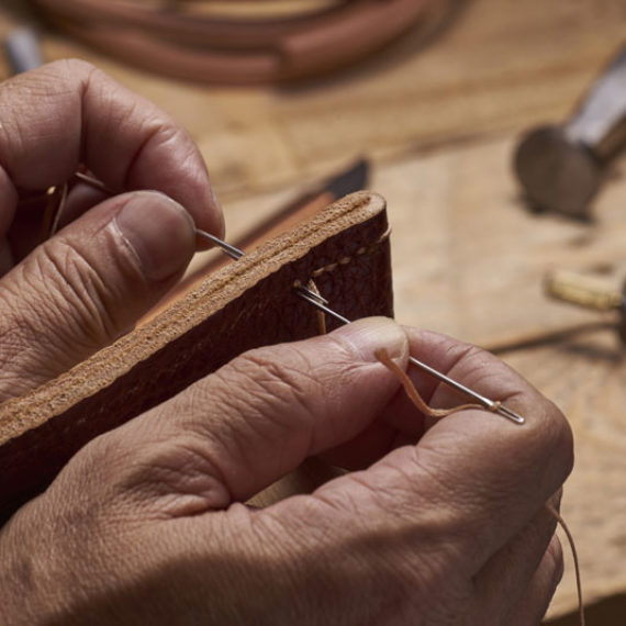 a man making a handmade product